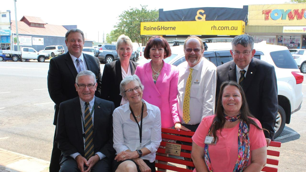 MEMORIAL BENCH: Deputy Mayor Gavin Jones, Cr Roz Frohloff, Cr Kathy Duff, former Cr Terry Fleischfresser and CEO Mark Pitt along side former Mayor Keith Campbell, former Cr Ros Heit and Cr Danita Potter at the first installation of the red bench in November 2019. Photo: Laura Blackmore