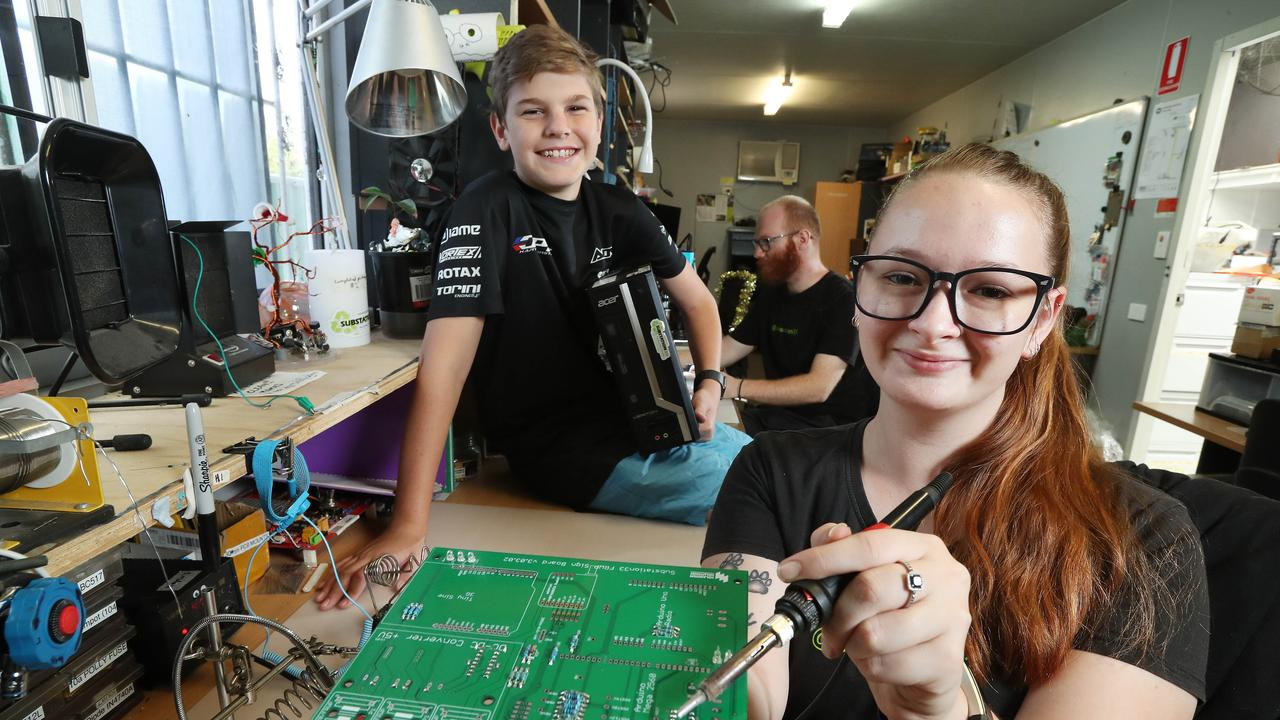 Harry Green, 15, of Jimboomba with his refurbished computer. Kayla Poulter and Jesse Pullen are part of the Substation 33 team of volunteer computer technicians building computers for Queensland kids in need. Photographer: Liam Kidston