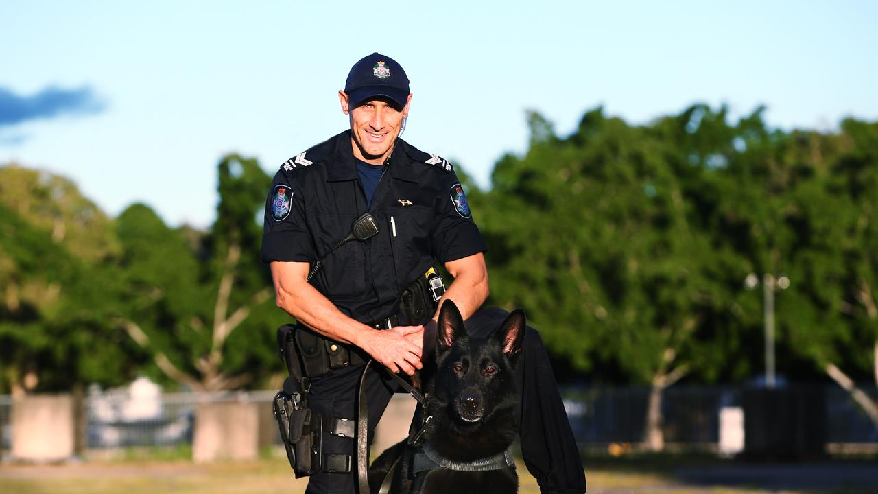 Senior Constable Adrian Marek with his dog Bally. PICTURE: BRENDAN RADKE