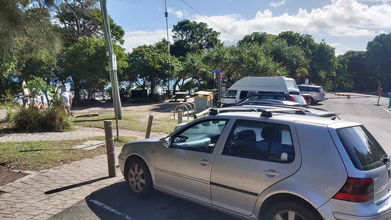 Beachgoers head back into the surf as carparks around Byron Bay reopen.