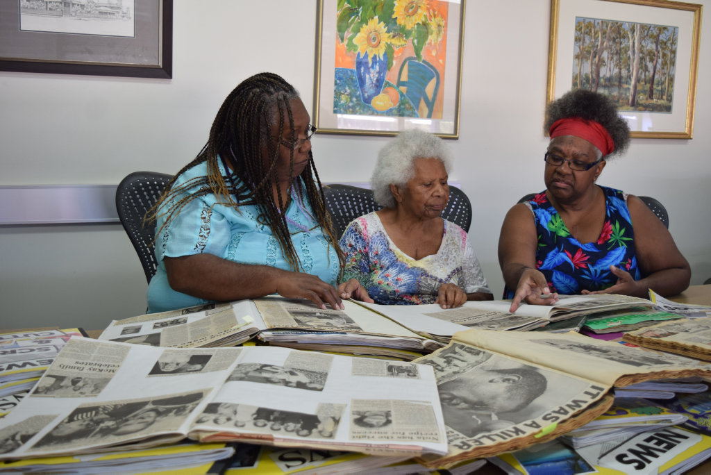 Image for sale: Donnielle Fatnowna and Stephanie Fatnowna with their mum, Kay Fatnowna (middle), who has been collecting clippings from the Daily Mercury for more than 50 years. Picture: Heidi Petith