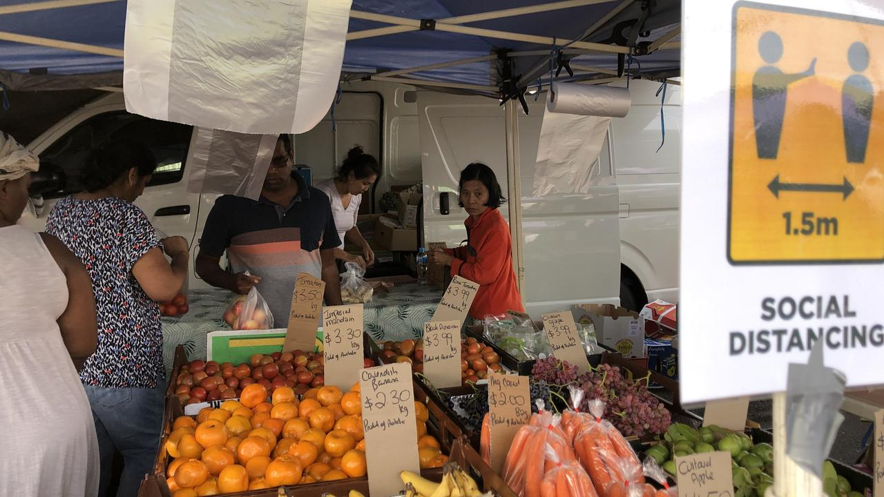 Signs and Stall holders at the Woodridge Global Food Markets on Sunday.