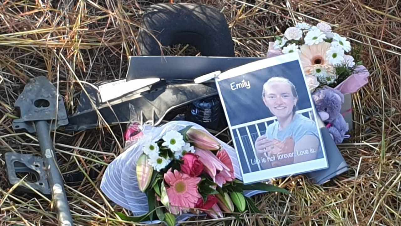ROADSIDE TRIBUTE: Emily Barnett's family left a heartbreaking tribute to her by the side of the Bruce Highway at the place where she lost her life on Friday.