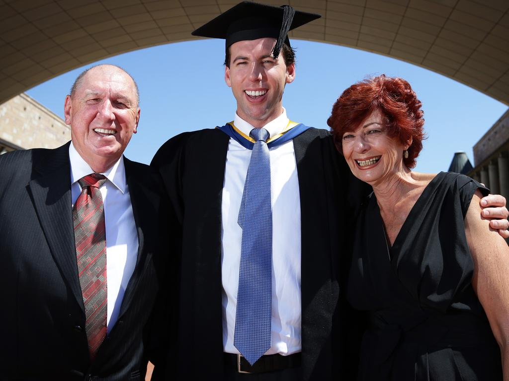 Hackett with his parents Neville and Margaret after graduating from Bond University on the Gold Coast in 2012. Picture: Adam Head