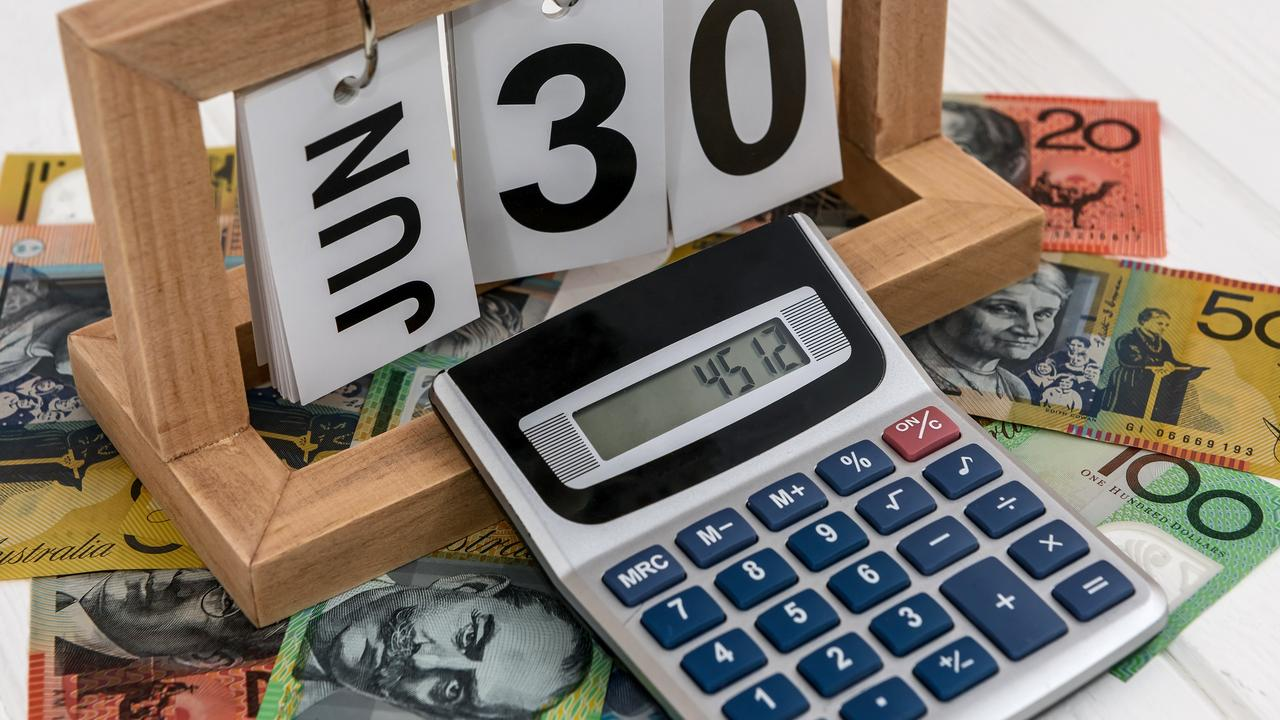 Calculator with wooden calendar and australian dollar banknotes