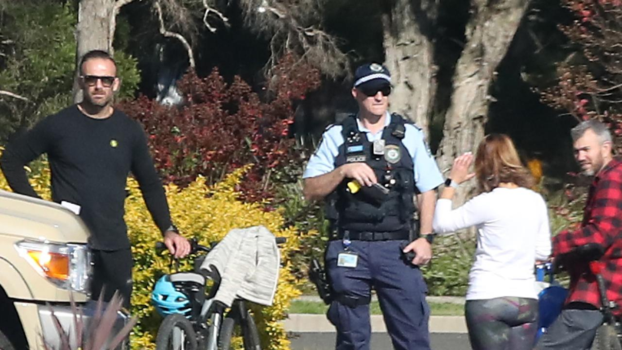 Celebrity trainer Commando Steve Willis (left) and his new girlfriend Harika Vancuylenberg with police in Kellyville on Sunday. Picture: David Swift