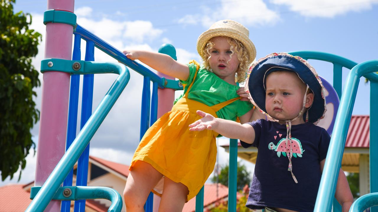Peta Baker's daughters Yindi and Dharma on the equipment in Memorial Park in 2019, which Mrs Baker says gets 'excruciatingly hot.' Picture: Alex Treacy