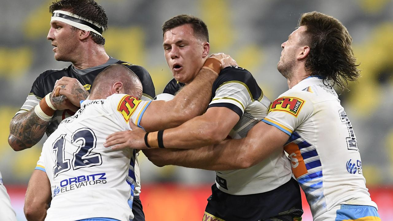 Scott Drinkwater of the Cowboys is tackled during the round three NRL match between the North Queensland Cowboys and the Gold Coast Titans. (Photo by Ian Hitchcock/Getty Images)
