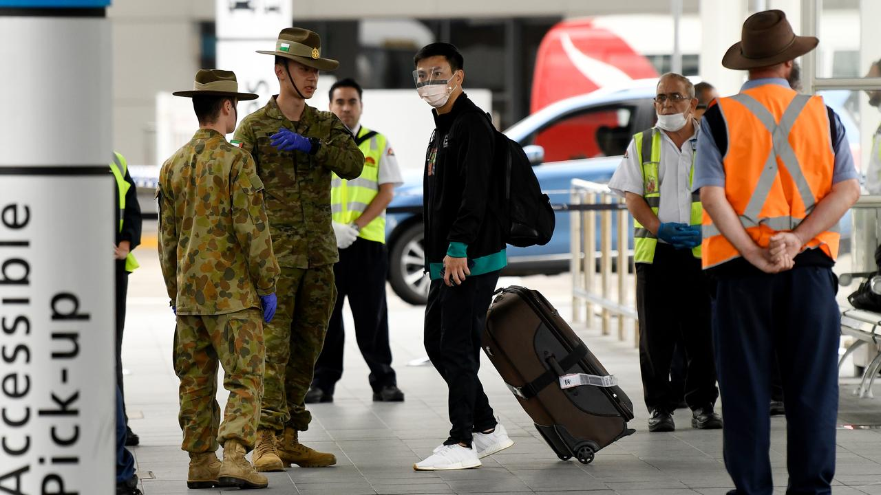 ADF personnel assisting escorting travellers at Sydney International Airport in Sydney as they are put into quarantine hotels. Picture: Bianca De Marchi