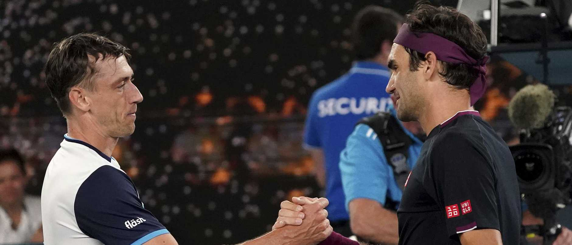Brisbane's John Millman, left, shakes hands with Switzerland's Roger Federer following their match at the Australian Open tennis championship in Melbourne. Millman lost narrowly - after beating the Swiss great at the US Open. (AP Photo/Lee Jin-man, File)