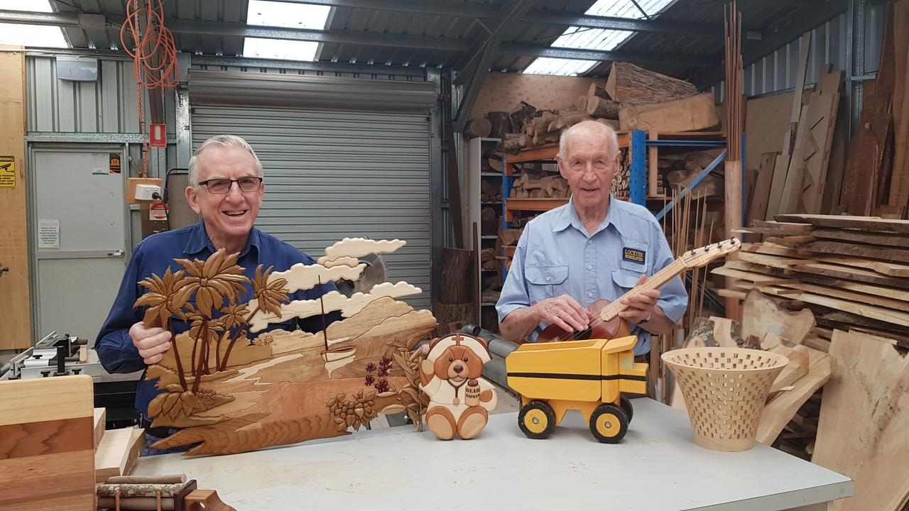 BACK SOON: Members of the Lockyer Valley Woodcrafters group Geof Mercer and Brian Vickery check their 'holiday' projects while waiting for the shed to open again.