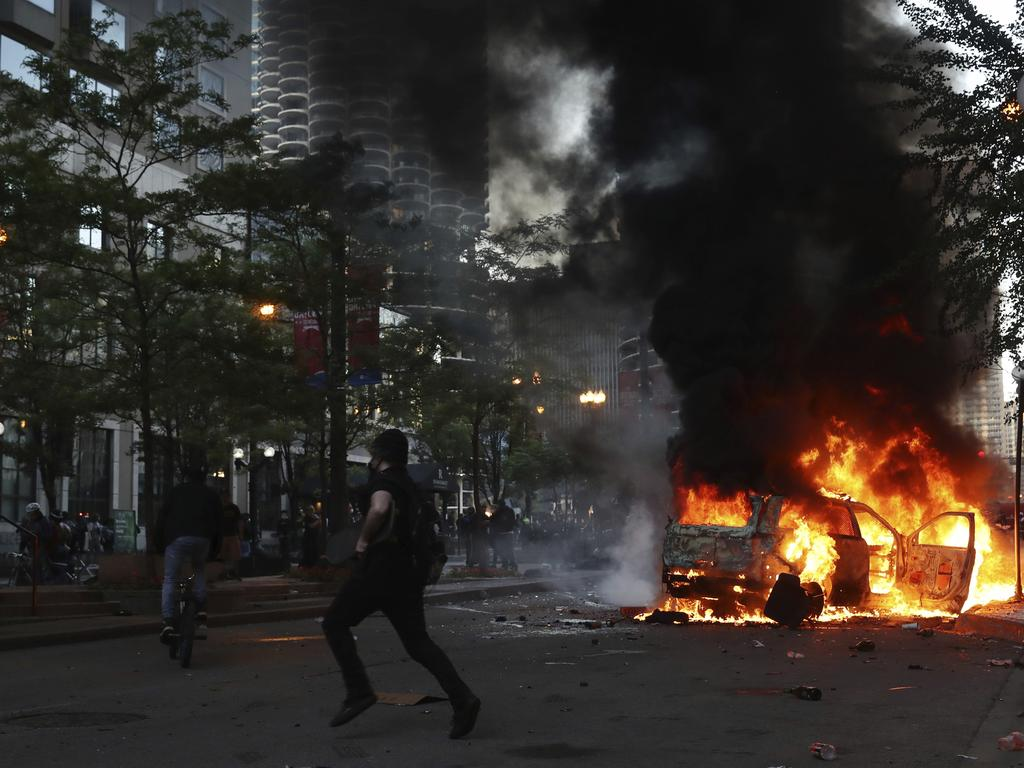 A car burns in Chicago after a march and rally over the death of George Floyd. Picture: John J. Kim