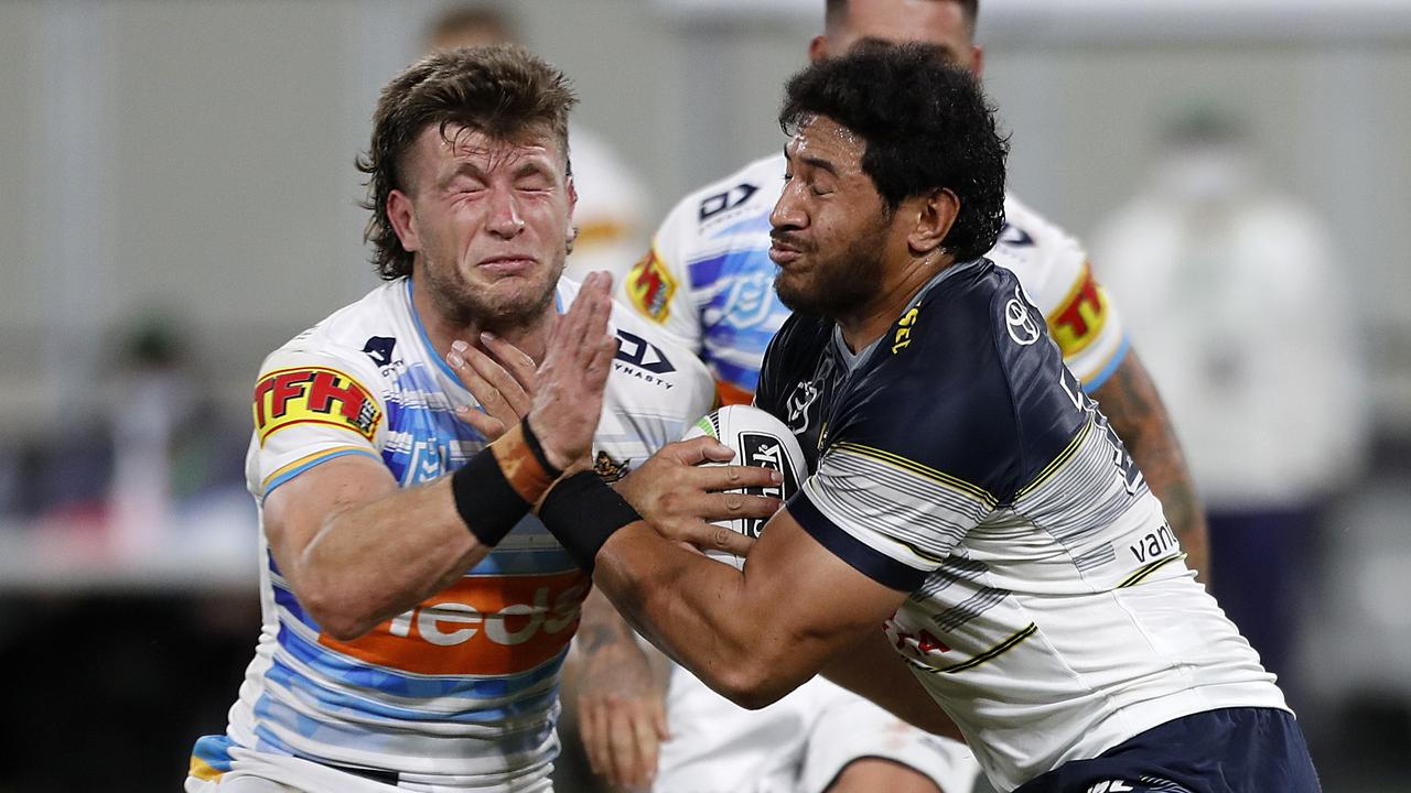 Jai Arrow of the Titans tackles Jason Taumalolo of the Cowboys during the Round 3 NRL match between the North Queensland Cowboys and the Gold Coast Titans at Queensland Country Bank Stadium in Townsville, Friday, May 29, 2020. (AAP Image/Cameron Laird)