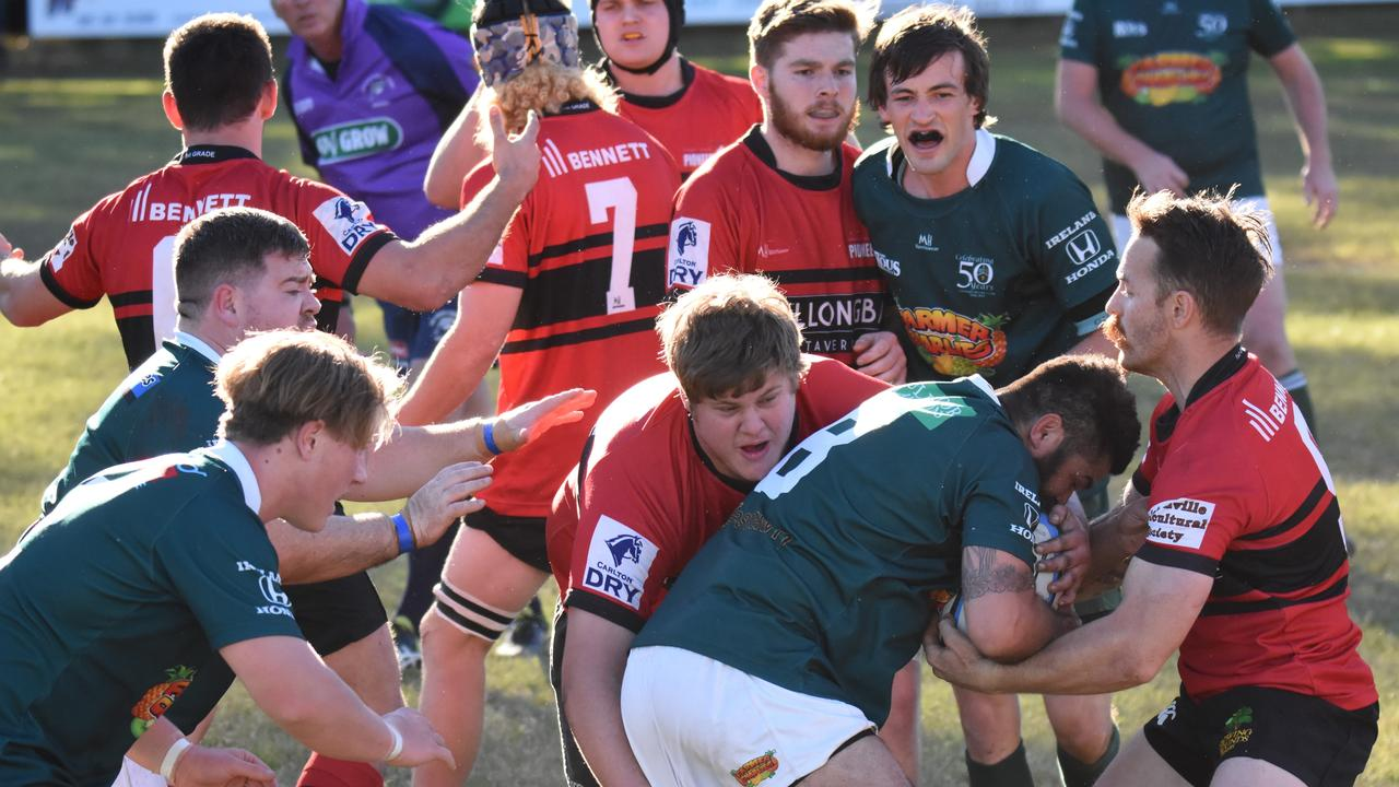 LOOKING HEAD: Lismore Rugby Union Club hopes to be back on the field such as when No 8 Nigel Marshall (centre in green) was wrapped up by the Wollongbar-Alstonville defence, as COVID-19 restrictions ease. Photo: Vicki Kerry