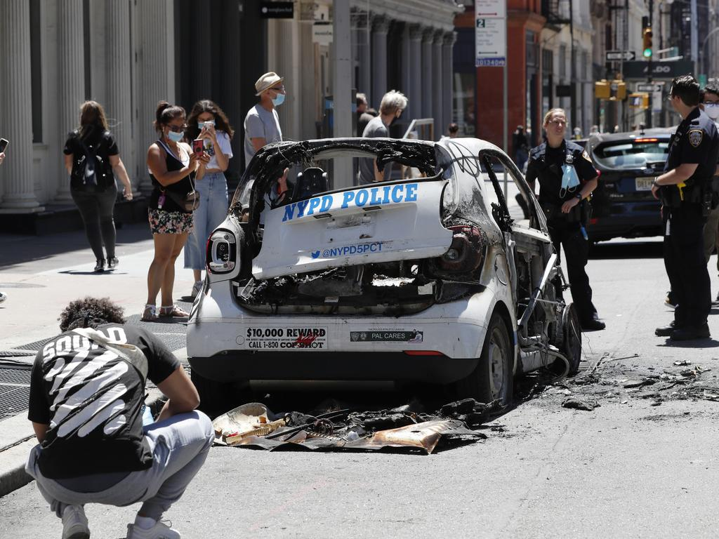 A burned-out and abandoned New York City Police vehicle. Picture: Kathy Willens
