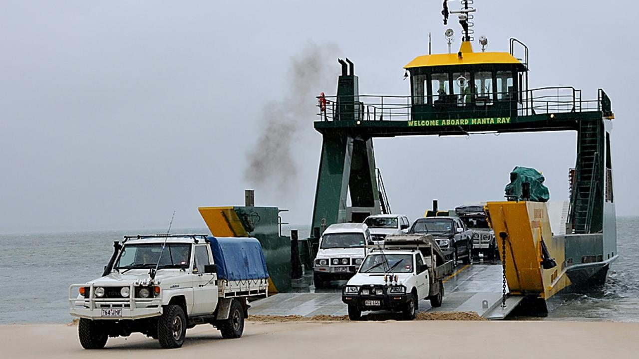 4WDs disembark from the Manta Ray barge at Inskip Point. Photo by Gympie Times.