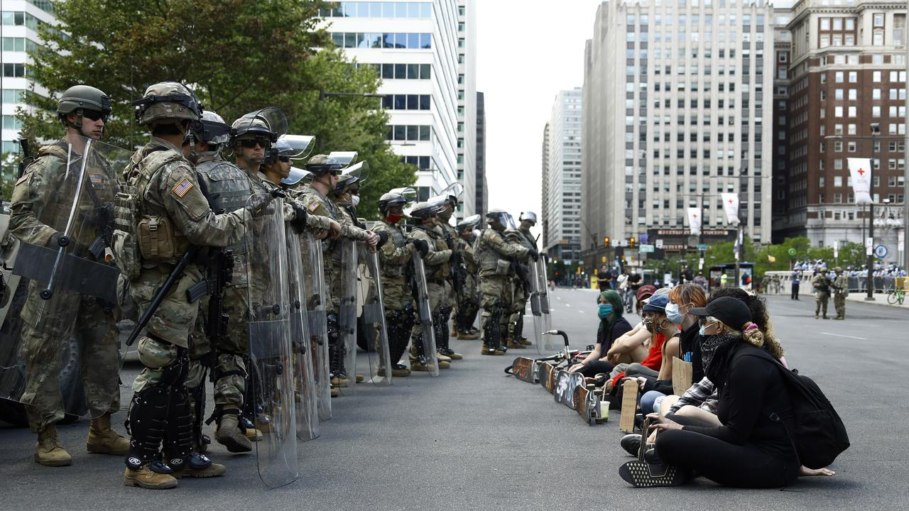 Pennsylvania National Guard holding shields face peaceful protesters. Picture: Matt Slocum/AP