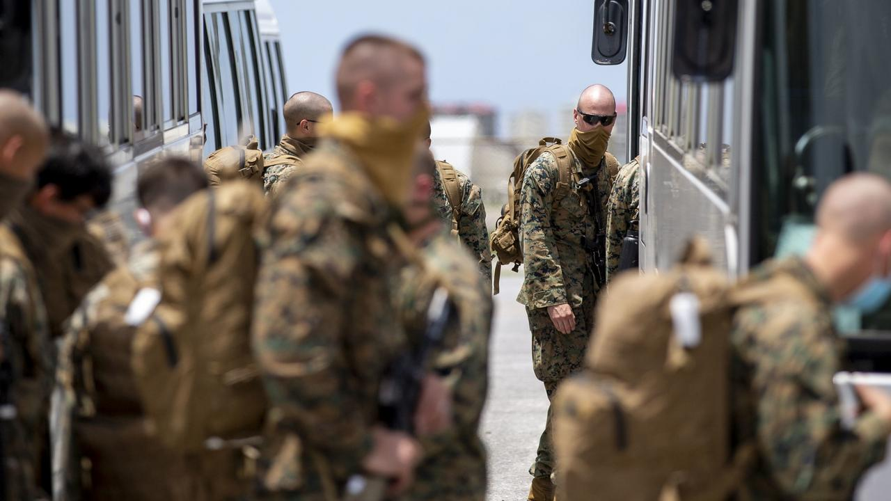 Last year's rotation of US Marines disembark at RAAF Base Darwin. The 2020 contingent is expected soon and faces strict quarantine protocols. Picture: Harrison Rakhshani