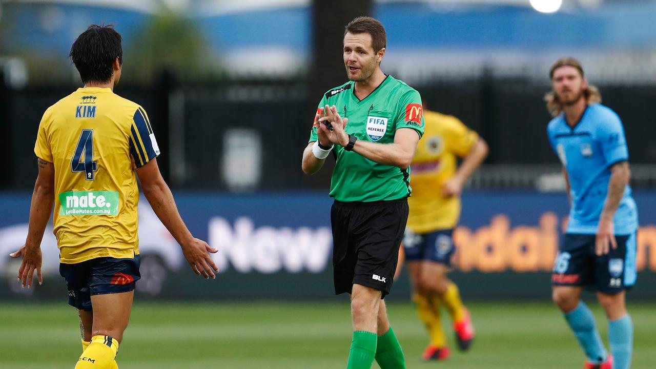 Referee, Chris Beath speaks with Kim Eun-Sun of the Mariners after VAR reviewed and disallowed a Mariners goal during the Round 20 A-League match between the Central Coast Mariners and the Sydney FC at Central Coast Stadium in Gosford, Sunday, February 23, 2019. (AAP Image/Brendon Thorne) NO ARCHIVING, EDITORIAL USE ONLY