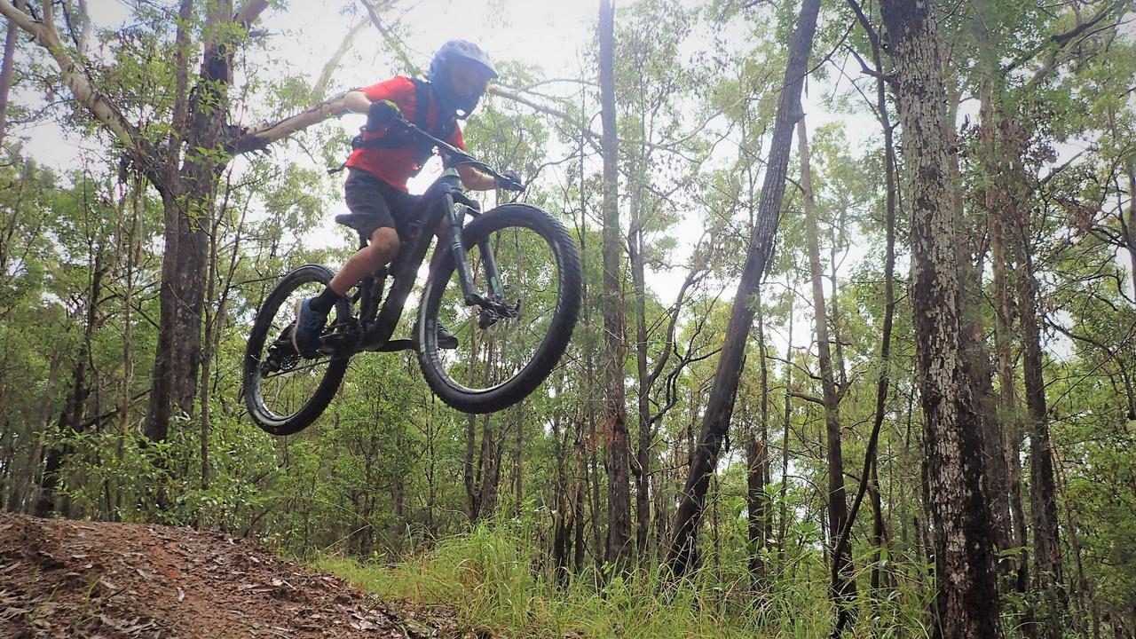 A go for it Luca Wyatt, 9, finds some air out on the Noosa trails.