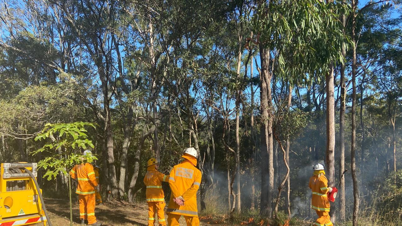 Queensland Rural Fire Service firefighters conducting a hazard reduction burn. Photo: Queensland RFS