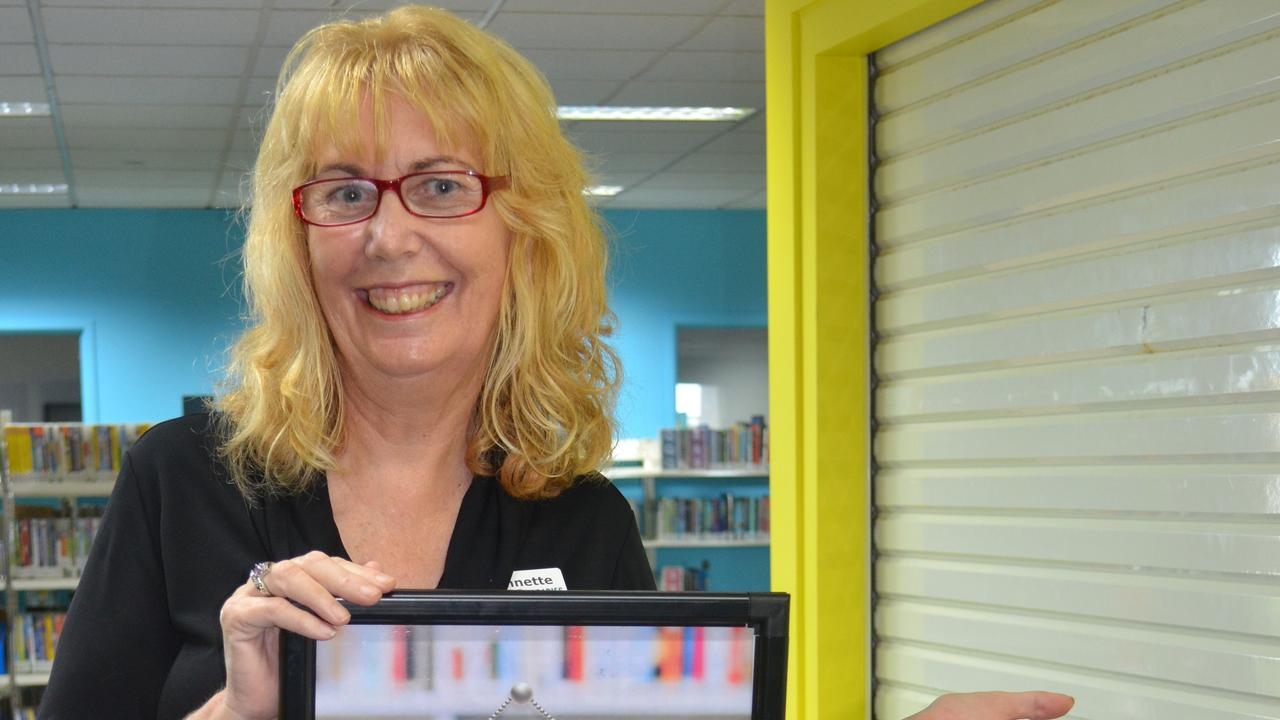 Fraser Coast Libraries senior library assistant Annette Turner is among many staff preparing to welcome readers back to the Hervey Bay and Maryborough libraries. PHOTO: Contributed.