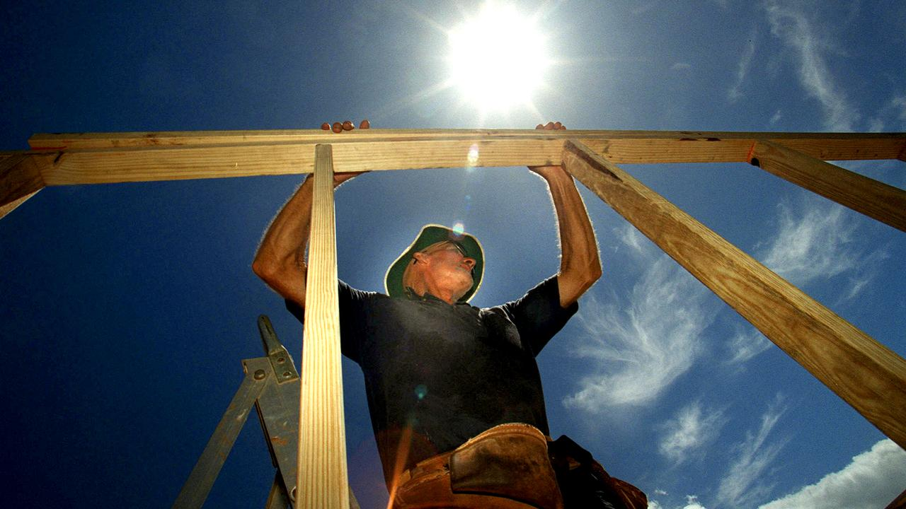Generic photo of man building a house.