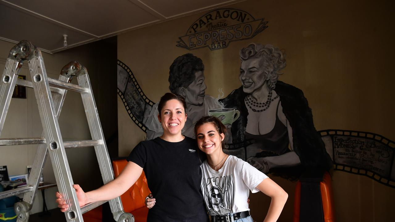 MEANINGFUL MURAL: The Paragon Theatre owner Merissa Craft and employee / artist Tianni Hooper. Picture: Mike Knott.