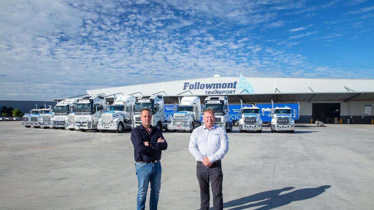 Followmont Transport boss Mark Tobin (left) celebrates the arrival of the new trucks with Steve Helms from VCV Brisbane North.