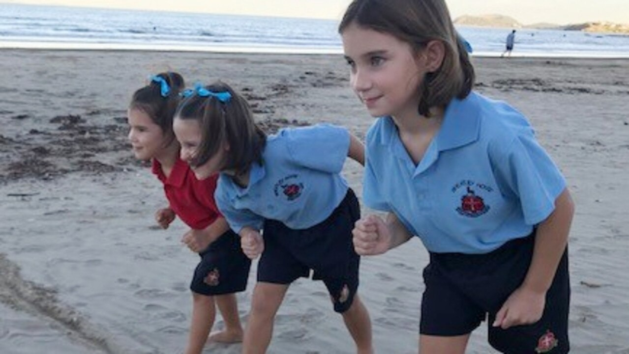 READY, SET: Mahalia, Anabella and Kiana Van Der Loos get ready to add to the Wheatley House kilometres tally in Rockhampton Grammar's virtual cross country. Picture: Contributed