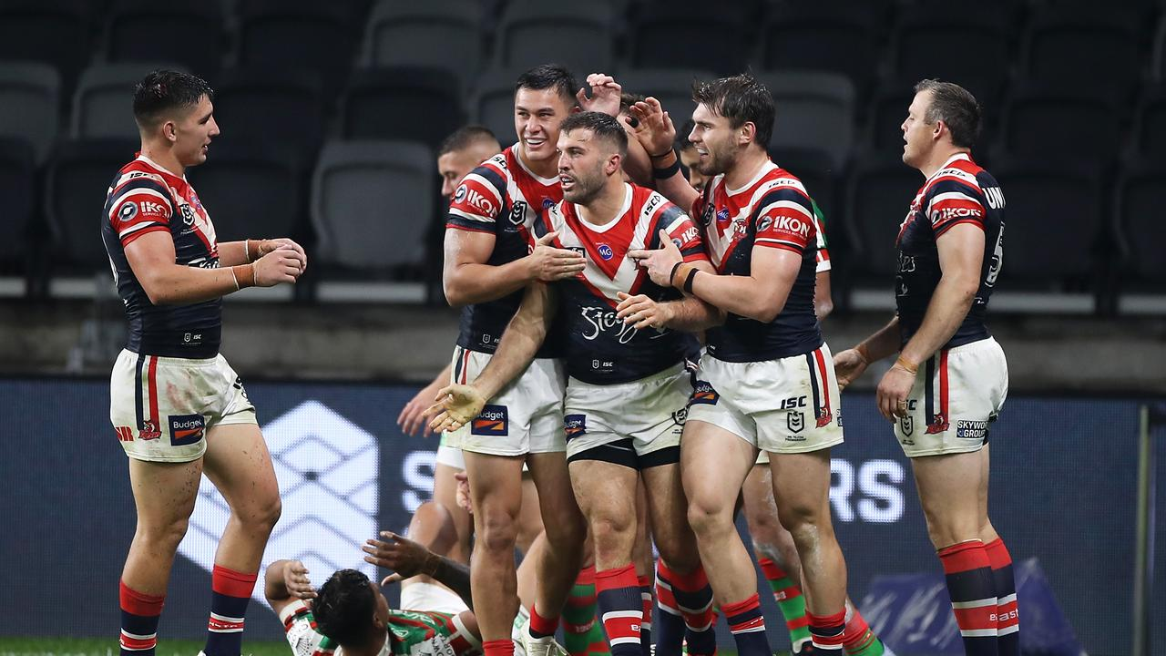 SYDNEY, AUSTRALIA - MAY 29: James Tedesco of the Roosters celebrates with his team mates after scoring a try during the round three NRL match between the Sydney Roosters and the South Sydney Rabbitohs at Bankwest Stadium on May 29, 2020 in Sydney, Australia. (Photo by Mark Kolbe/Getty Images)