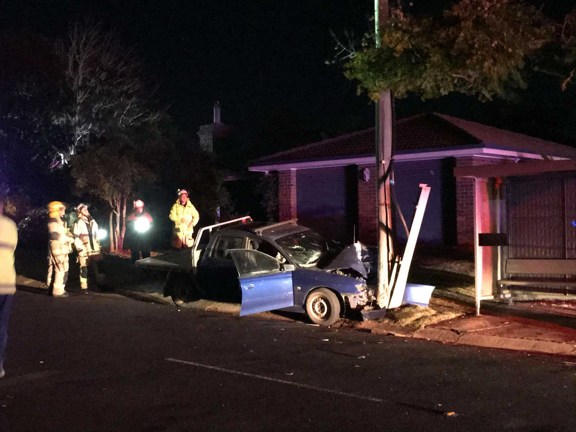 A resident snapped this photo of the scene after a car crashed into a power pole last night. Photo: Jess Ryder.