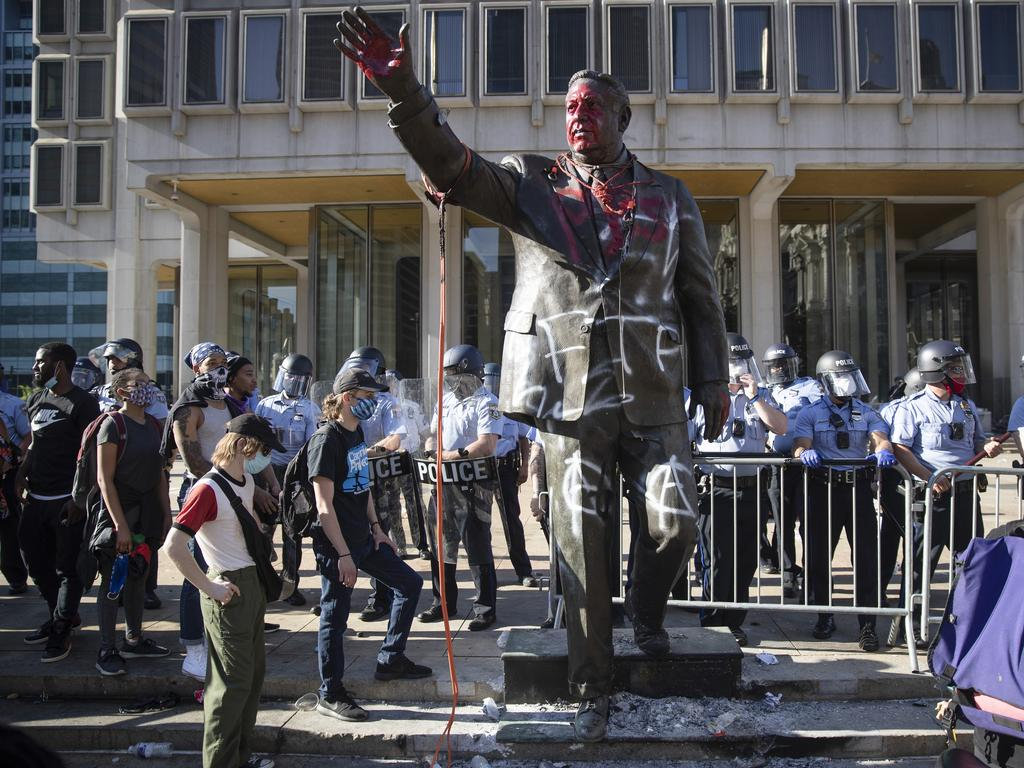 "The statue of controversial former Philadelphia Mayor Frank Rizzo, who urged people to ""vote white"" was removed by authorities. Picture: AP"