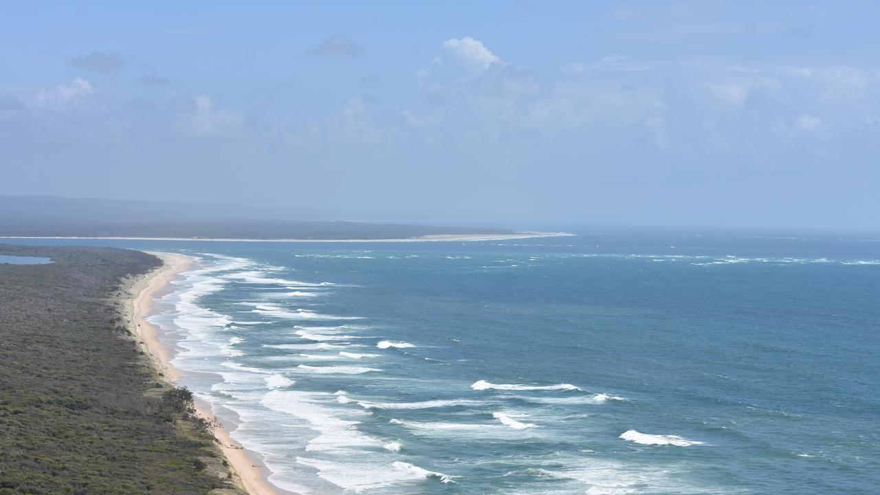 Inskip Point ocean beach with Wide Bay Bar and Fraser Island to the north.