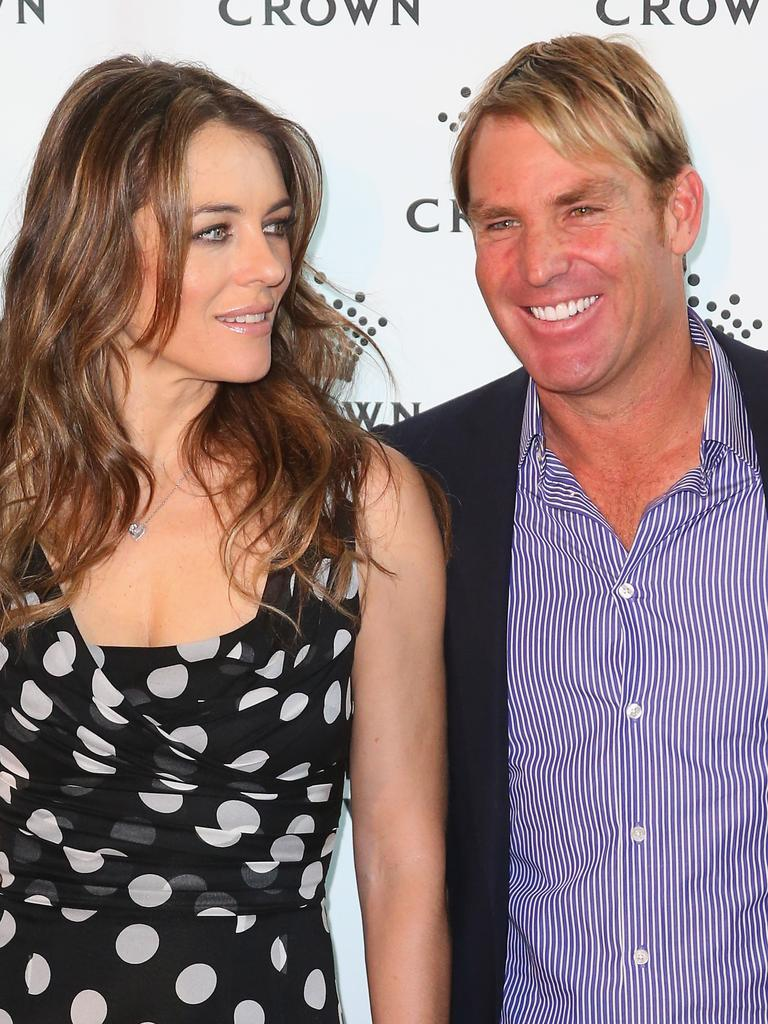 MELBOURNE, AUSTRALIA – NOVEMBER 12: Shane Warne and Elizabeth Hurley pose as they attend the launch of the Shane Warne Foundation's Ambassador Program at Club 23 on November 12, 2013 in Melbourne, Australia. (Photo by Scott Barbour/Getty Images)