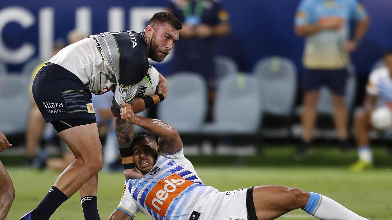 Kyle Feldt of the Cowboys (left) during the Round 3 NRL match between the North Queensland Cowboys and the Gold Coast Titans at Queensland Country Bank Stadium in Townsville, Friday, May 29, 2020. (AAP Image/Cameron Laird) NO ARCHIVING, EDITORIAL USE ONLY