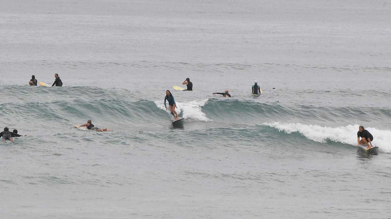 Surfers at Alexandra Headland. Photo: John McCutcheon / Sunshine Coast Daily