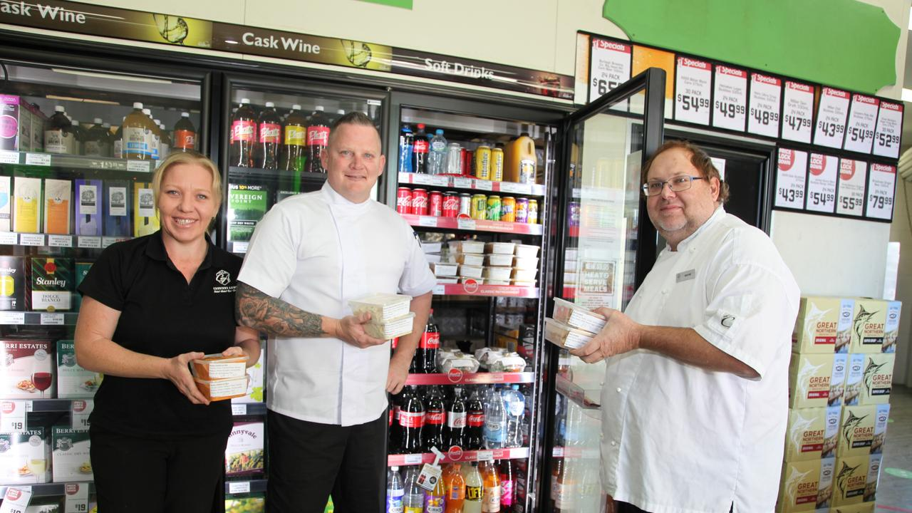 Carriers Arms Hotel catering manager Paul Redpath (centre) and staff Kylie Teasdell and Wayne Gadischke fill the fridge with takeaway meals.