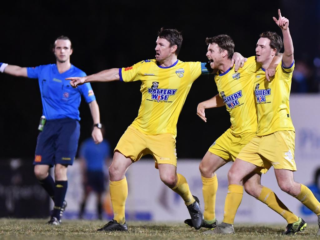 BACK ON FIELD: Kawana Force celebrate their grand final victory over Nambour Yandina United last year. There will be no finals football when the competition resumes. Photo Patrick Woods
