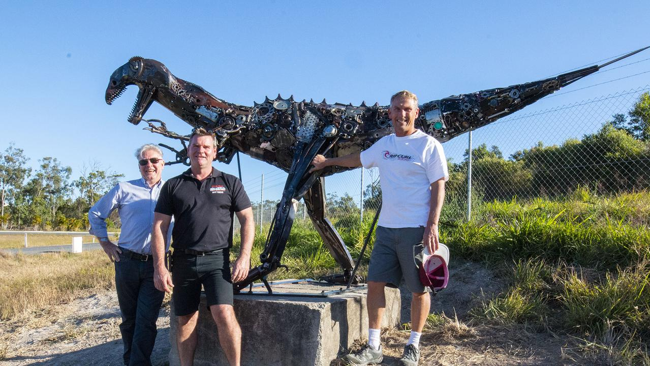 TALENT: Yeppoon builder and artist Steve Ross (pictured with Livingstone Shire Council's Russell Claus and Pat Eastwood) shows off his impressive sculptures.