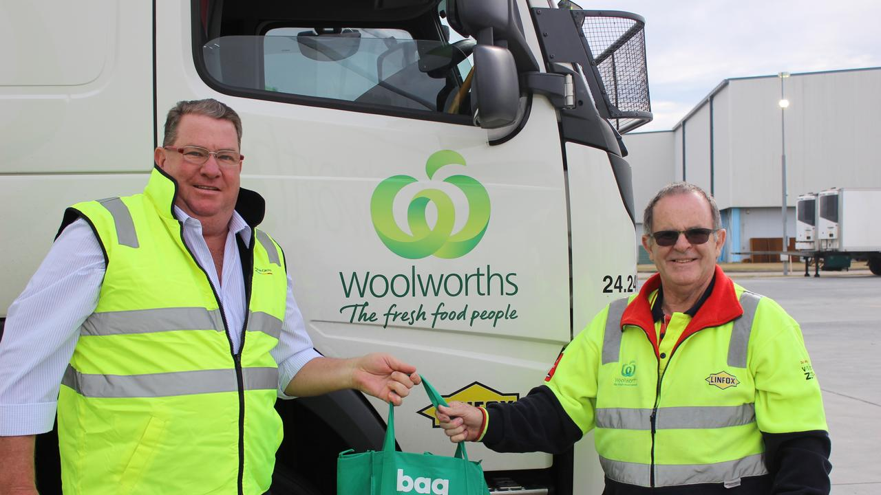 JOB WELL DONE: Assistant Minister for Road Safety and Freight Transport, Scott Buchholz hands a care package over to truckie Dean Murray.