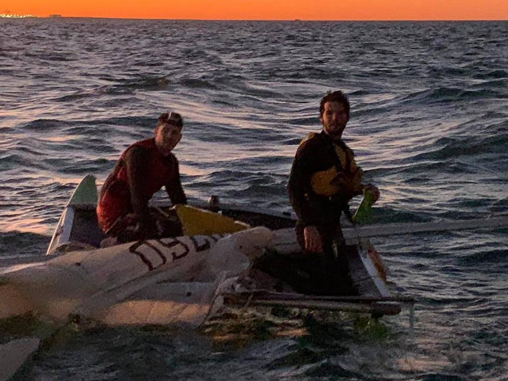 Guy Sherro and Samuel Martel rescued by the Brisbane Coast Guard after capsizing in Moreton Bay. Photo: Brisbane Coast Guard – QF2