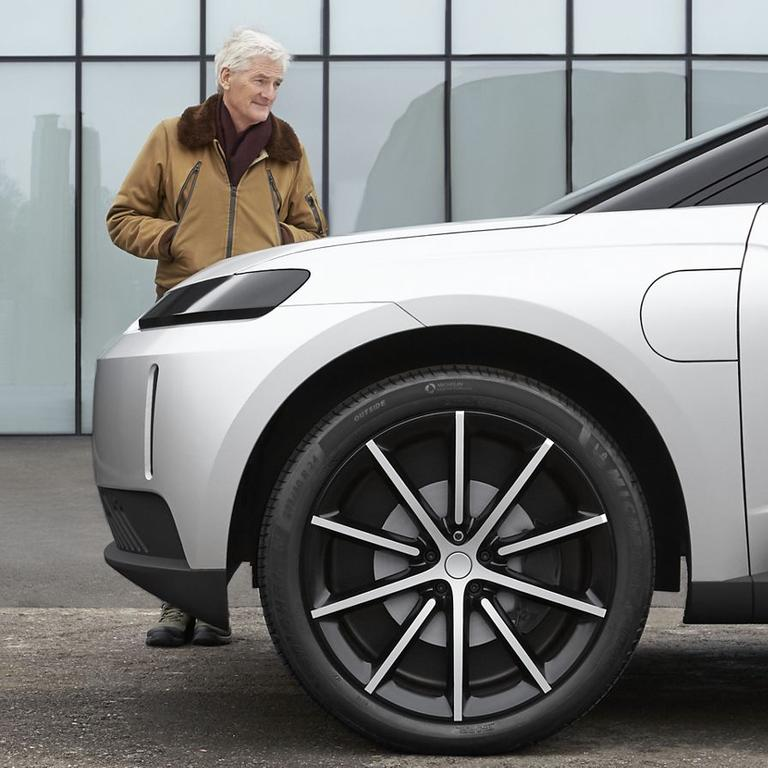Sir James Dyson admires the abandoned Dyson electric car he said he personally poured more than $900 million into.
