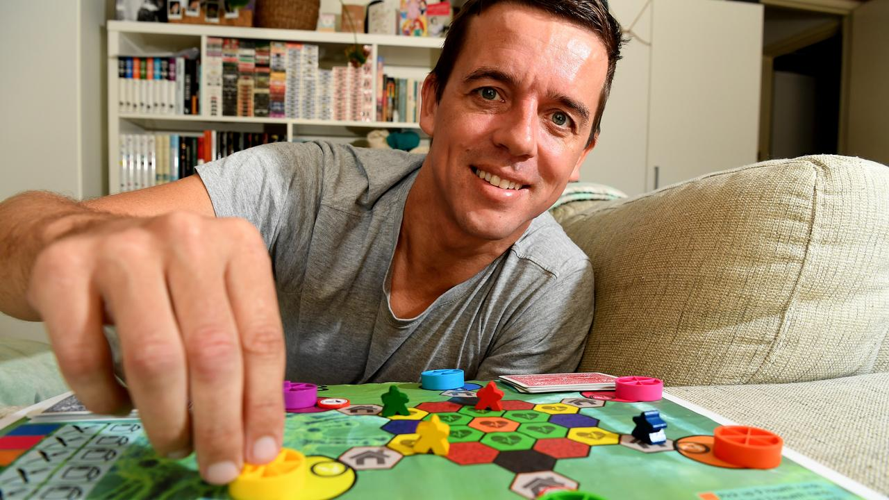 FAMILY FUN: Andy Cox, more commonly known as Andino the Magician, is in the final stages of creating a board game called Stage 3 as part of his Bachelor of Game Design at USC. The goal is to survive COVID-19 lockdown. Photo: Warren Lynam