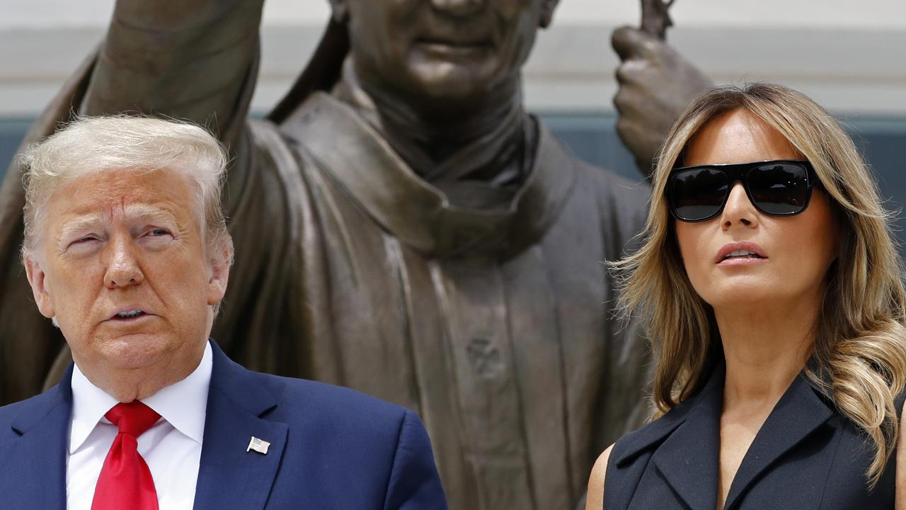 President Donald Trump and first lady Melania Trump outside the Saint John Paul II National Shrine on Tuesday. Picture: Patrick Semansky/AP