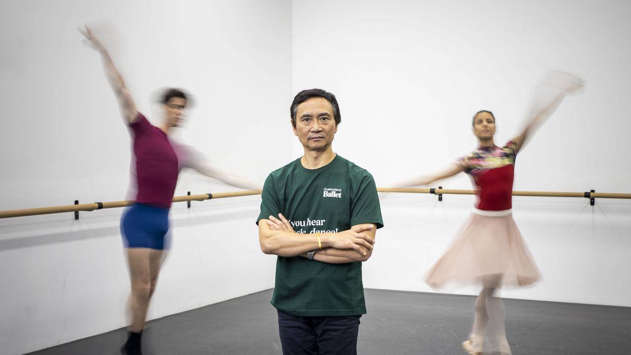 Queensland Ballet Company Artistic Director Li Cunxin with dancers Vito Bernasconi (left) and Yanela Pi – era (right). Picture: Glenn Hunt
