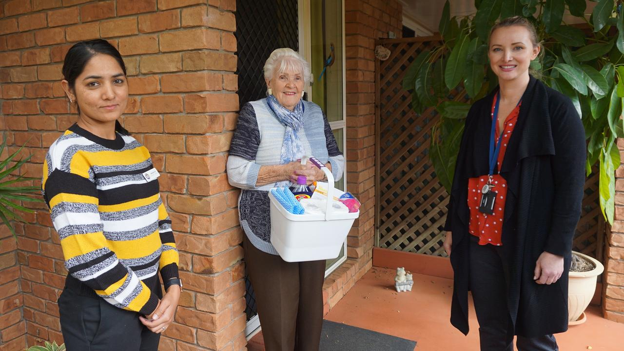 Using a Clean Bucket Pack are (from left) YellowBridge QLD property officer Baljinder Gill (left), Nora King, and Department of Housing and Public Works customer service manager Anita Weier.