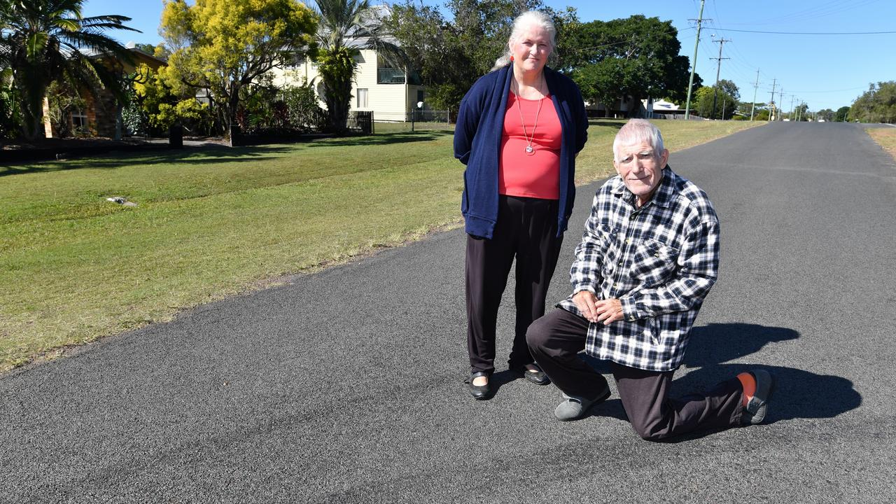 Neill and Christine Bucton from Granville with skidmarks in their street.Photo: Alistair Brightman