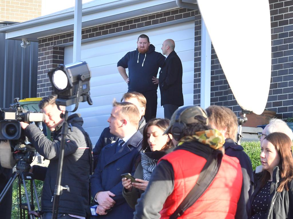 The homeowner pictured at the end of the press conference – the media pack now off his grass. Picture: AAP