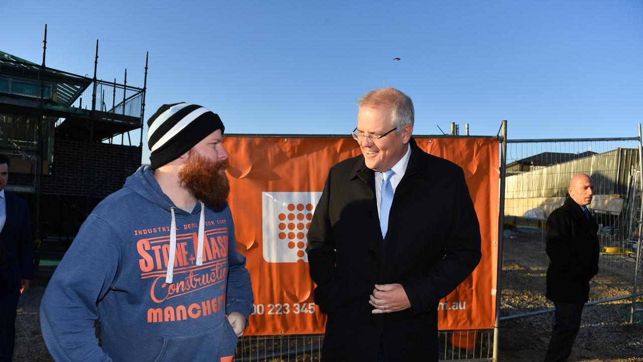 Prime Minister Scott Morrison with a local resident at a media event to announce the new HomeBuilder stimulus package in the NSW town of Googong, 25km east of Canberra. Thursday, June 4, 2020. (AAP Image/Mick Tsikas)
